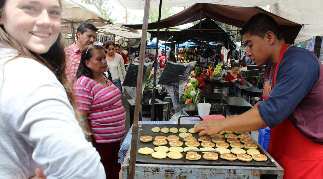 A volunteer walking around the street markets in Mexico and ordering food to get more familiar with the language